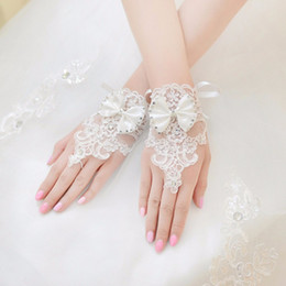 Wholesale White Tulle Gloves - White Fingerless Bridal Gloves Wrist Length Beaded Lace Applique Butterfly Detail Sheer Tulle Wedding Accessories 2017