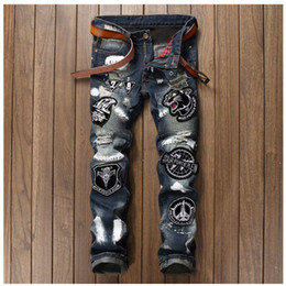 Wholesale Trousers Style For Men Jeans - Wholesale- Men Badge Patchwork Jeans Ripped Biker Hole Denim Patch Jeans for Men Embroidery Straight Slim Jeans Pants Night Club Trousers