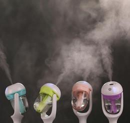 Großhandel Nanum Auto Luftbefeuchter Mini Air Mist Diffusor Luftreiniger Auto Luftbefeuchter Luftreinigung Tragbare Wasserflasche Dampf Luftbefeuchter 2016 HEIßER von Fabrikanten