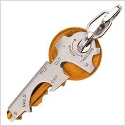 Commercio all'ingrosso Multi-funzione Ferramenta True Utility 8-in-1 Multi EDC Strumento In acciaio inox Portachiavi Apribottiglie Nail File Thread Cutter da