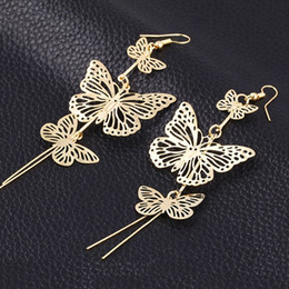 Wholesale European Butterfly Dangles - Multi-level long paragraph hollow tassel butterfly earrings European and American ear jewelry manufacturers wholesale