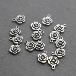 Argentina 10 UNIDS Caliente al por mayor Rose botón de Metal Accesorios de BRICOLAJE Accesorio para Collar Pulsera Mecanizado de piezas de Plata-joyería Making Suministro