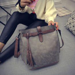 1181327e2577 ashion shoulder bags HISUELY Hot Sale New Women PU Leather Handbags Tassel  Fashion Designer Black Bucket Vintage Shoulder Bags Women Mess.