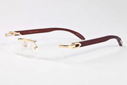 Lunettes rouges pour femmes en Ligne-2017 sans monture corne de buffle lunettes hommes femmes lunettes de soleil avec boîte blanc rouge noir bois bambou lunettes lunettes