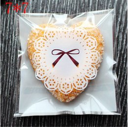 Wholesale Pastry Bags Packaging - 100 pcs lot 7*7cm White Color Lace Bow Print Biscuit Cookies Packaging Bag Candy Cake and Pastry Heat seal Plastic Bag