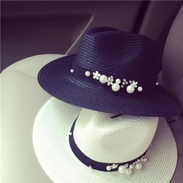 Wholesale Rivet Hats - Wholesale- New Spring Summer Hats For Women Flower Beads Wide Brimmed Jazz Panama Hat Sun Visor Beach Hat Flower Pearl rivet Straw Hat