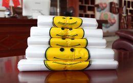 Wholesale Transparent Bag Material - Transparent Smiling Face Portable Plastic Bags Customized Fresh Material Waterproof Multi-purpose Vest Shopping Bags