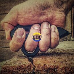 Al aire libre EDC G10 Perlas de cerámica de resina epoxídica Golpe de dedo Nudillo Duster Punch Tigre Dedo Mecanizado Peso ligero Durable Gran sensación de Hande desde fabricantes