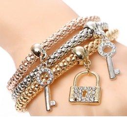 Wholesale Stretching Lock - Diamond key lock pendant bracelet alloy three - color stretch corn chain suit