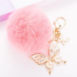 Wholesale Pink Rhinestone Butterfly Pendant - 8CM Rabbit Fur Ball Plush Keychain Round Ball with Bling Bling Butterfly Metal Keychain Keyring Car Keychains Purse Charms Handbag Pendant
