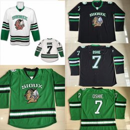 Camisetas de hockey de la universidad online-# 7 TJ Oshie North Dakota Hockey Jersey Logotipos de bordado cosidos 100% para hombre Fighting Sioux DAKOTA Jerseys de hockey universitario Negro Blanco verde