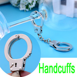Wholesale Handcuff Keychain Wholesale - Creative keychain Small Handcuffs Cool metal Keychain Man Women Gift Small Gift Car keys bag pendant Key Ring Decoration B101Q