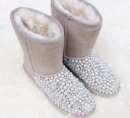 Wholesale Half Pearl Flat - Selling! The new winter snow boots, handmade pearl diamond waterproof boots, high to help European and American pearl bust boots, flat shoes
