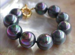 Wholesale Wholesale Sea Shell Pearl Strand - Rare Huge 12mm Genuine Rainbow Black South Sea Round Shell Pearl Bracelet
