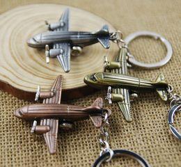 Wholesale wholesale airplane keychains - Fashion Mini 3D Airplane Keychain Aircraft Pendant Keyring Keyfob Small Plane Key Chain Cute Christmas Gift 3 Color C14L