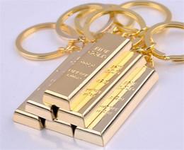 Llaveros de oro para hombre online-llavero de oro llaveros de oro llaveros encantos del bolso colgante llavero de metal buscador de lujo hombre llaveros del coche accesorio R068