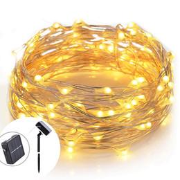Luces de cadena LED de 33 pies 100, Cable de cobre con energía solar Luces de cadena estrelladas con panel de control para el patio interior al aire libre Bodas de Navidad desde fabricantes