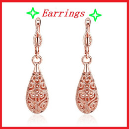 Wholesale Hollow Rose Crystal Earrings - Rose 18 K gold jewelry Stud Earrings Creative Drop Earrings Environmental protection material gold plated hollow pattern acc248
