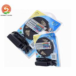 2019 éclairage à bande led bon marché 2016 pas cher nouvelle 5M Flexible RGB LED bandes 5050 SMD 5M 300 leds IP65 imperméable à l'eau IR contrôleur à distance + 5A adaptateur led light roll éclairage à bande led bon marché pas cher