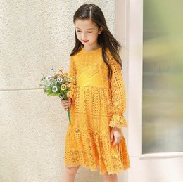 Wholesale Teenage Dresses - Retail 2017 Autumn New Teenage Girls Dresses Yellow Lace Hollow Out Princess Long Sleeve Dress Children Clothes 5-14T E17014