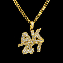 Wholesale Gun Brass - Men's Fashion AK47 letters Submachine Gun Pendant Necklace European Hip Hop Jewelry Gold Plated Bling Rhinestone Necklace