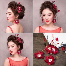 Wholesale Red Hair Wigs Pieces - Woman headdress hair Lomen bride three piece silk red headdress flower earring wedding red red dress hair 154132