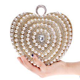 Bolso del día de la boda de la novia online-Bolsos de novia de la boda Bolso lujoso Con cuentas Diamantes Bolsos de noche Anillo Piedras del día Embragues Día Diseño Corazón Bolsa de perlas