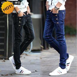 Wholesale Hip Hop Boys Jeans - Wholesale-Fashion Teenagers Stretch Slim Fit Black And Blue Button Designers Casual Jeans Boys Hip Hop City Streetwear Men Pencil Pants