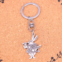 Wholesale Keyrings Musical Wholesalers - New Fashion musical rabbit trumpet Keychains Antique Silver plated Keyholder fashion Solid Pendant Keyring gift
