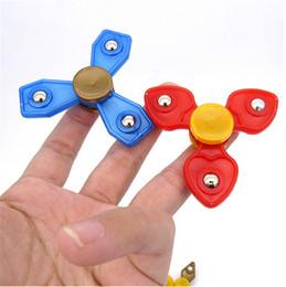 Canada Enfants Main Fidget Spinner enfants Handspinner EDC Triangle filles garçons Doigt Astuce Spinning Coloré Décompression Anxiété Jouets cadeaux Offre