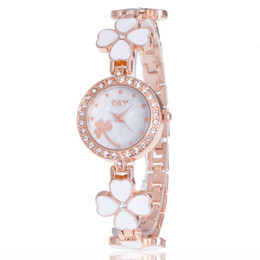 Wholesale casual form - Fine New Style Alloy Crystal Clover bracelet watches ceramic watches female form female models women Girl Wrist Watch