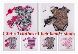 Canada vêtements pour enfants ensembles gros bébé montée vêtements combinaisons salopettes infantile avec bande de cheveux chaussures léopard zèbre costume trois pièces cheap infant zebra tutu Offre