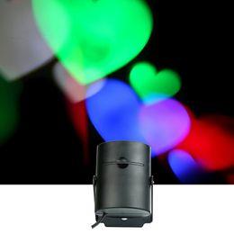 Proiettore a forma di luce online-Proiettore portatile LED laser illuminazione del prato inglese della lampada 4 sostituzione delle lenti Party Bar romantico matrimonio decorazione della parete di Holloween a forma di cuore