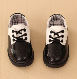 Wholesale Girls Hollow Shoes - British fashion style boys girls leather shoes student performance shoes black white Hollow children casual kids sports sneakers