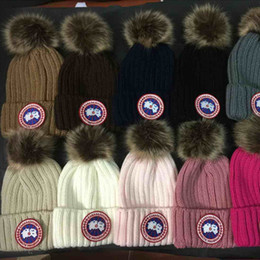 Wholesale Girls Skiing - wholesale 12 Solid Color Fashion Winter brand Hat For Women Warm Knitted Hat Girls Ski Hard Hat Cap Female Warm Cap Skullies Hats For Women