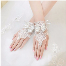 Wholesale Plain Gloves - Free Shipping In Stock Lace Bridal Gloves With Bow Beaded Fingerless Wrist Length Short Bridal Wedding Gloves
