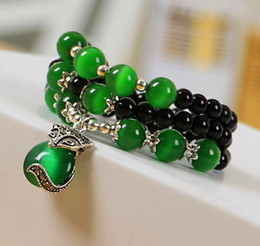 Wholesale Agate Eye Beads - National wind original bracelet new lady agate possession silver fox pendant green cat eyes Buddha beads hand small gift explosion section