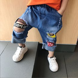 Wholesale Infant Toddler Jeans - Toddler hole Jeans Fashion letter Boy Jeans Denim Fashion new blue Ripped Baggy Children Jeans Kids Trouser Boys Clothes Infant Wear A460