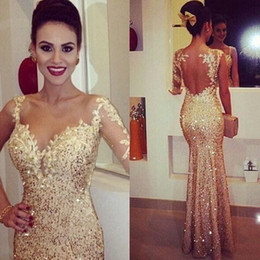 Wholesale Spark Light - Sparking Gold Fitted Evening Dresses 2017 Lace Appliques Sheer Long Sleeve Open Back Sequin Prom Dress Party Ball Glitzy Pageant Gowns