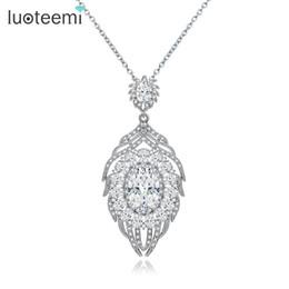 LUOTEEMI New Jewelry Design Luxious Tiny CZ Round singolo grande pendente di cristallo bianco oro-colore Vintage amore gioielli da sposa da grandi disegni di ciondolo d'oro fornitori