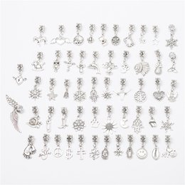 Wholesale Tibetan Charms Mix Wholesale - Mixed with 50 different styles of large hole charm tibetan silver big hole bead charm pendants fits European bracelets jewelry making M002