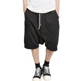 Al por mayor-2016 Nueva Negro Pantalones cortos Kanye West Cool Sweatpants Mens Jumpsuit HIPHOP Rock Stage Ropa urbana Owens Dress Harem desde fabricantes