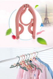 Wholesale Coats Racks - Space saver travel portable folding hangers rack outdoor clothes hangers multifunctional magic folding clothes plastic antiskid hanger