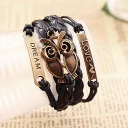 Wholesale charm hand chain bracelets - Wholesale- New Retro Adjustable Multilayer Hand-woven Leather Bracelet Owl Braided Rope Chain Wristband Alloy Fashion Jewelry For Men Women