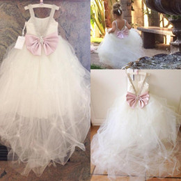 Wholesale cute cheap bows - 2017 Flower Girls Dresses For Weddings Beaded Spaghetti Pleated Tulle Cute Pink Bow First Communion Dresses Girls Pageant Gowns Cheap