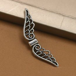 Wholesale Silver Tone Beads - Vintage Silver Tone Hollow Angel Wings Stainless Steel Beads DIY Bracelets For Women Charms Beads For Jewelry Making