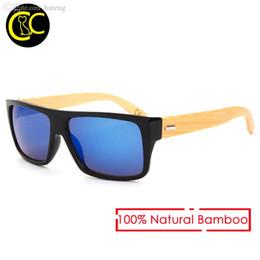 HOT SALE-New 2017 Óculos de sol de bambu Homens Óculos de sol de madeira  Mulher Marca Designer Espelho Óculos de sol de madeira original Oculos de  sol ... 58c7c3af8c