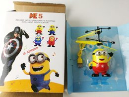 Wholesale Minion Lights - Electric Cartoon Aircraft Flying Toys Light Eyes Helicopter Despicable Me Minion Quadcopter Drone Hand Induction Light Mini Toys for Kids