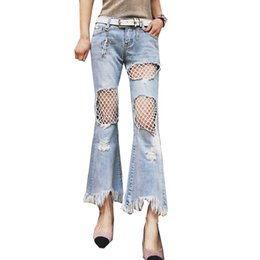 a37aea1e4af Spring New Knees Hole Flared Trousers Micro Horn Jeans with Fishnet Hollow  Design Wide Leg Loose Irregular Jean Pants for Fashion Women