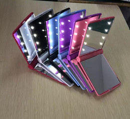 Argentina El nuevo espejo de maquillaje mini portátil plegable de mano cosmético maquillaje espejo de bolsillo con 8 luces LED para dama Suministro